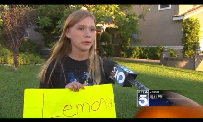Person takes free lemonade from little girls.